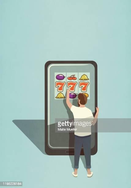 man playing slot machine game on large smart phone - toy stock illustrations