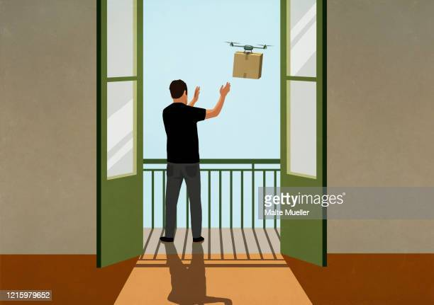 man reaching for drone package delivery on sunny balcony - consumerism stock illustrations