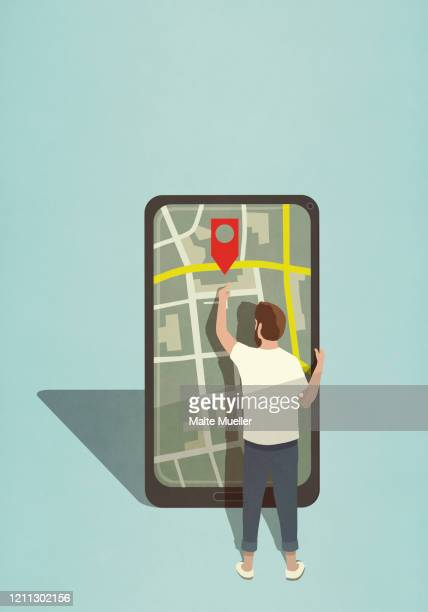 man reaching for map pin icon on large smart phone - journey stock illustrations