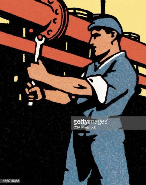 Man Repairing a Pipe