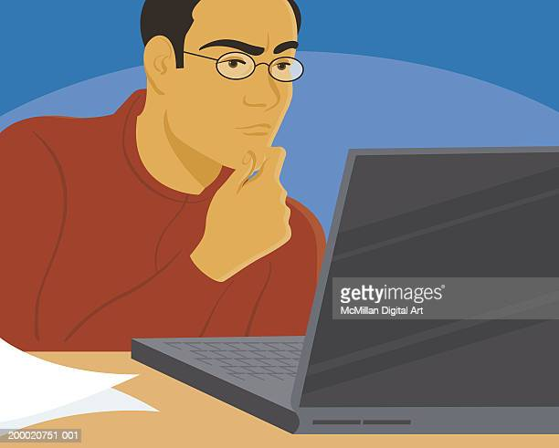 Man scratching chin while working on laptop, close-up