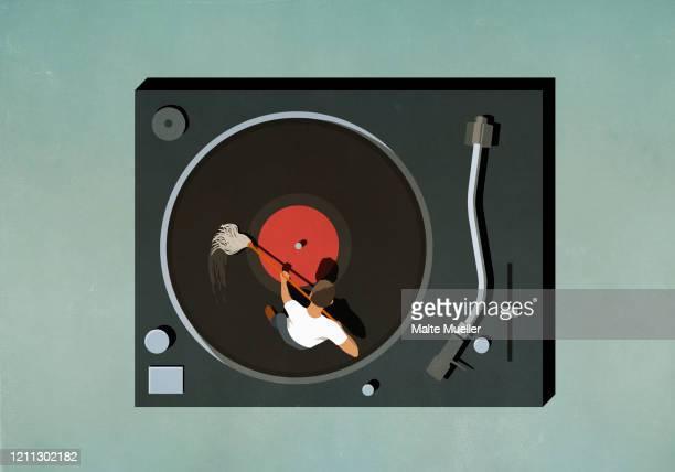 man scrubbing vinyl record - standing stock illustrations