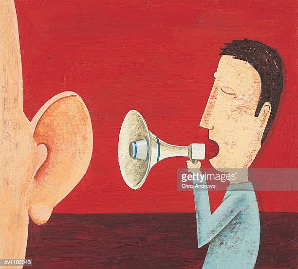 Man Shouting into a Megaphone into a Person's Ear