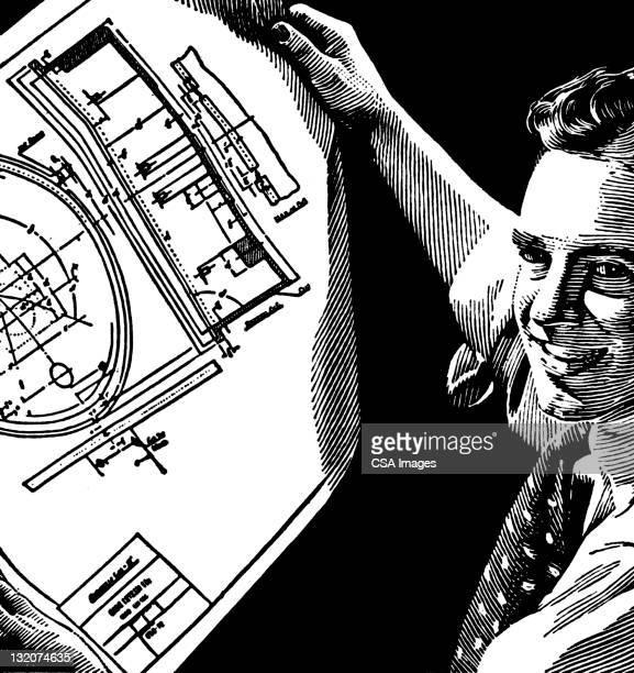 Man Showing blueprints