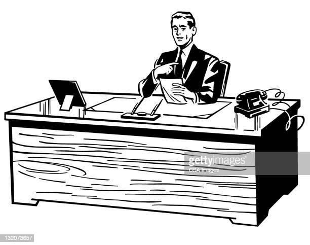 Man Sitting At Desk Gesturing