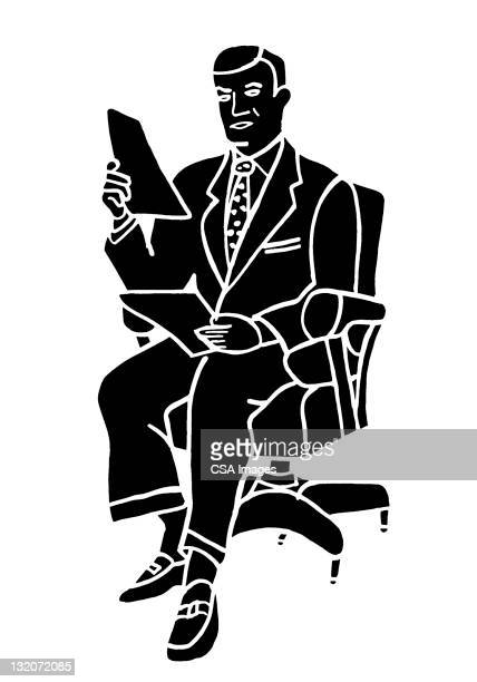 Man Sitting Holding Papers