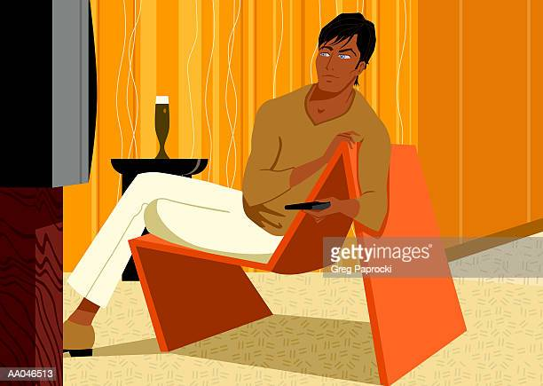 Man sitting on Deco chair, watching television