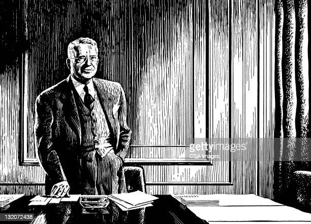 Man Standing at His Desk