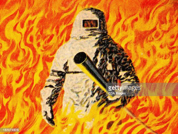 man standing in fire - in flames i the mask stock illustrations