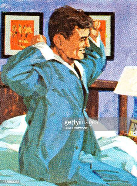 Homem na cama a fazer alongamentos