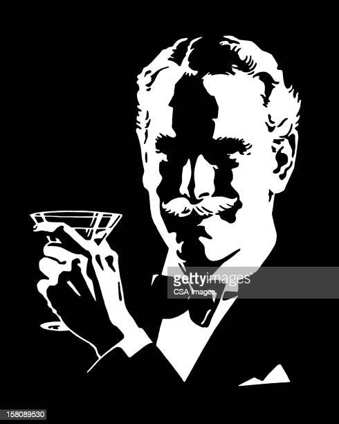 Man Wearing Bowtie Holding Cocktail