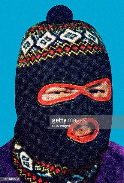 man wearing face mask - balaclava stock illustrations