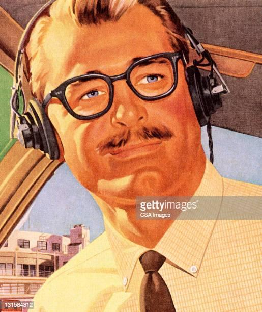 Man Wearing Headphones and Glasses