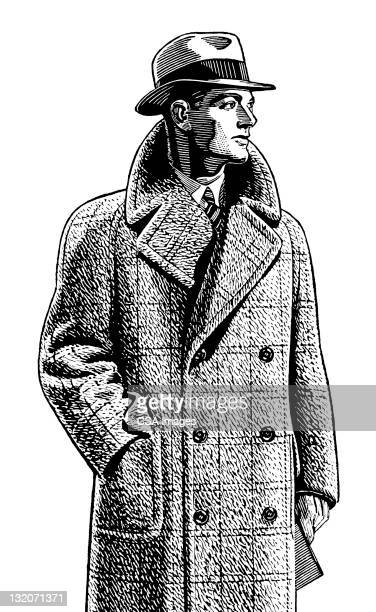 Man Wearing Overcoat and Hat