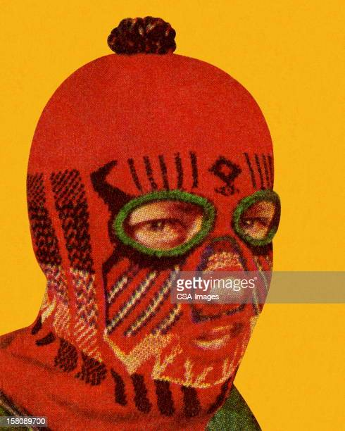 man wearing red face mask - balaclava stock illustrations