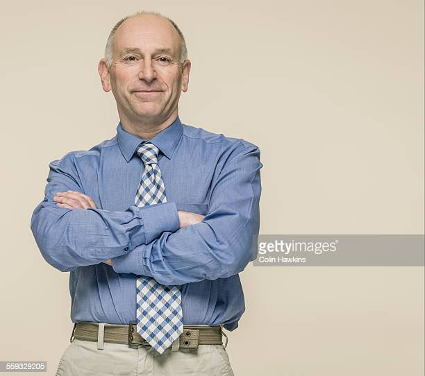 man wearing tie arms crossed - front view stock illustrations