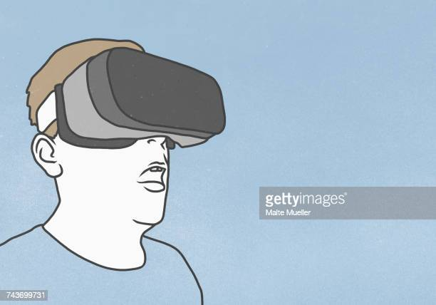 Man wearing Virtual reality glasses against blue background