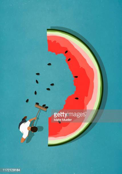 man with broom sweeping seeds from large watermelon slice - food and drink stock illustrations