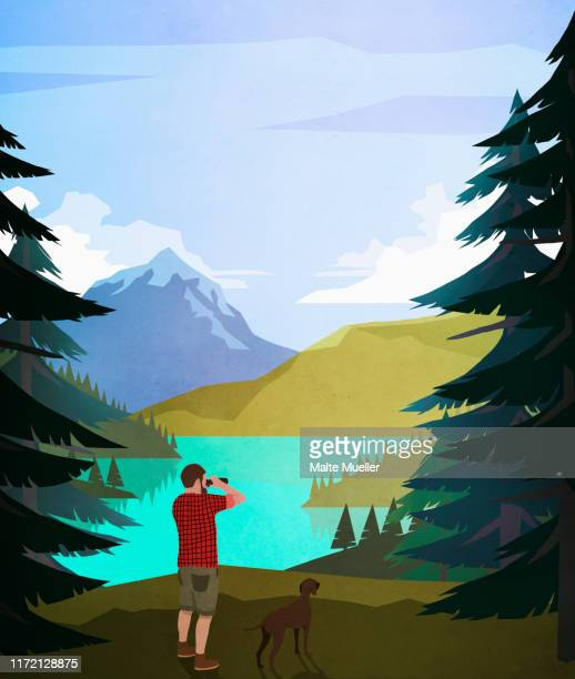 man with dog using binoculars at scenic lakeside - silence stock illustrations