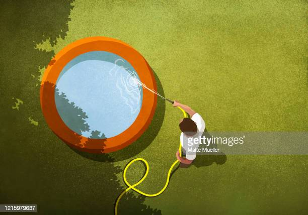 man with hose filling wading pool in sunny backyard - hose stock illustrations