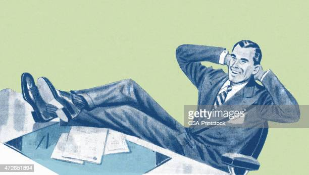 Man With Legs on Desk