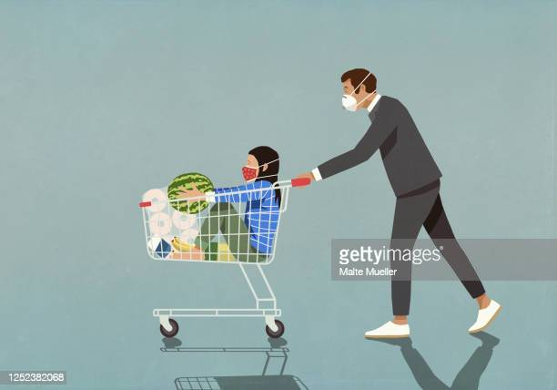 man with protective face mask pushing daughter in shopping cart - safety stock illustrations