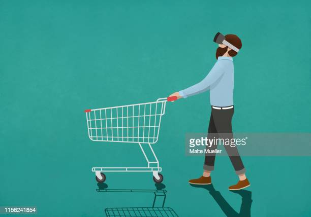 man with virtual reality simulator pushing shopping cart - shopping cart stock illustrations