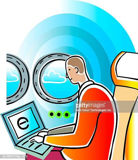 Man working with computer while in flight on commercial airplane