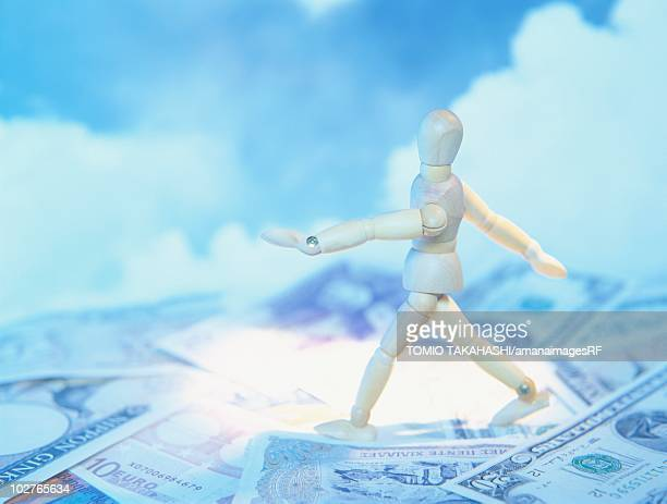 mannequin walking on bank notes in front of a cloudy sky - european union euro note stock illustrations, clip art, cartoons, & icons