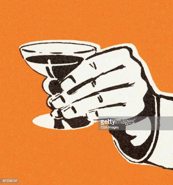 man's hand holding cocktail - martini stock illustrations