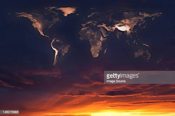 Map of the world in clouds at sunset