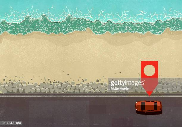 map pin icon above car driving along ocean road - social media stock illustrations