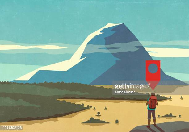 map pin icon above man hiking, looking at majestic mountain landscape view - social media stock illustrations