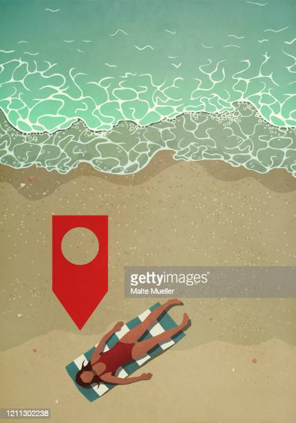 map pin icon above woman sunbathing on ocean beach - mobile app stock illustrations