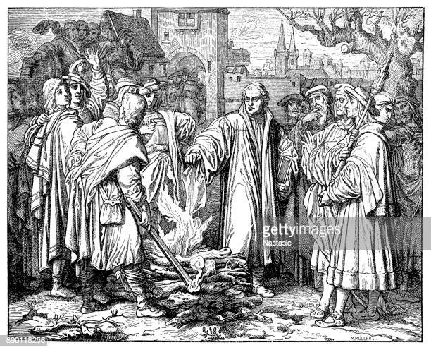 """martin luther burns the papal bull in wittenberg. this illustration appeared in gottfried's historical chronicle in 1619. the so-called """"exsurge domine"""" was a papal bull issued - protestantism stock illustrations, clip art, cartoons, & icons"""