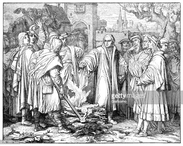 martin luther german burning of the papal bull in wittenberg - lutherstadt wittenberg stock illustrations