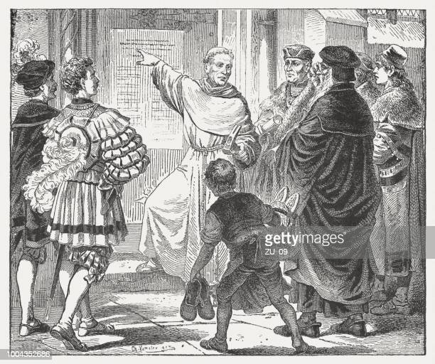 martin luther with his 95 theses in wittenberg, 1517 - lutherstadt wittenberg stock illustrations