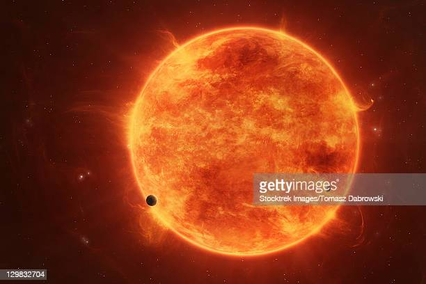 a massive red dwarf consuming planets within it's range. - solar flare stock illustrations, clip art, cartoons, & icons
