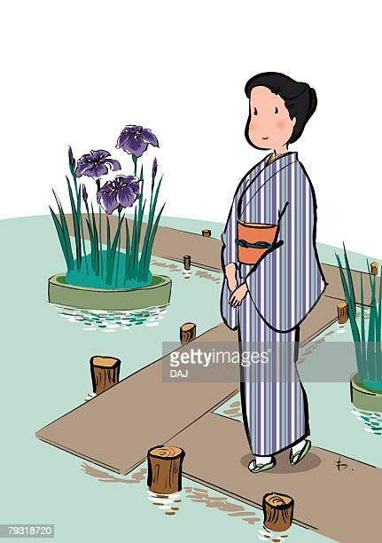 mature adult woman in kimono standing and watching iris in iris garden, high angle view - 45 49 years stock illustrations, clip art, cartoons, & icons