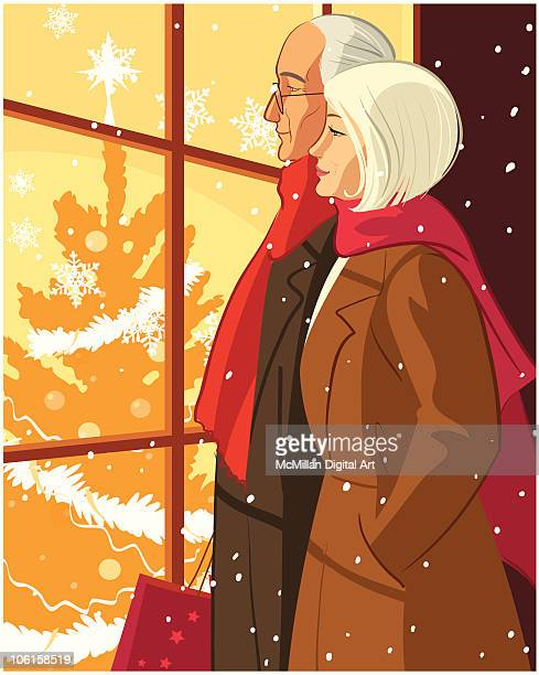 Mature man and woman window shopping at Christmas-time