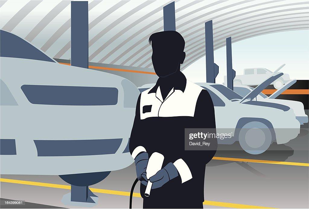 Mechanic with pneumatic gun