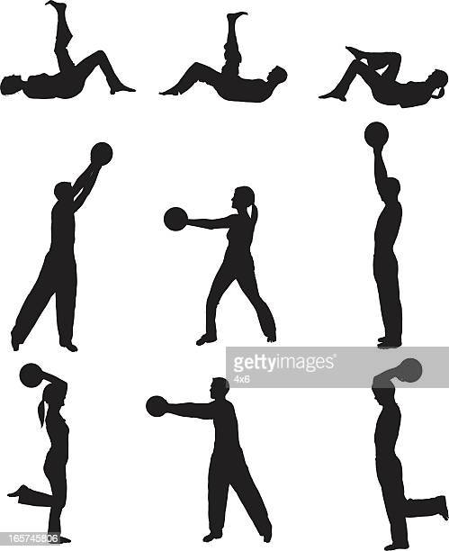 Men and women exercising with medicine ball
