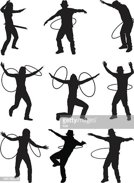 men and women hula hooping - plastic hoop stock illustrations
