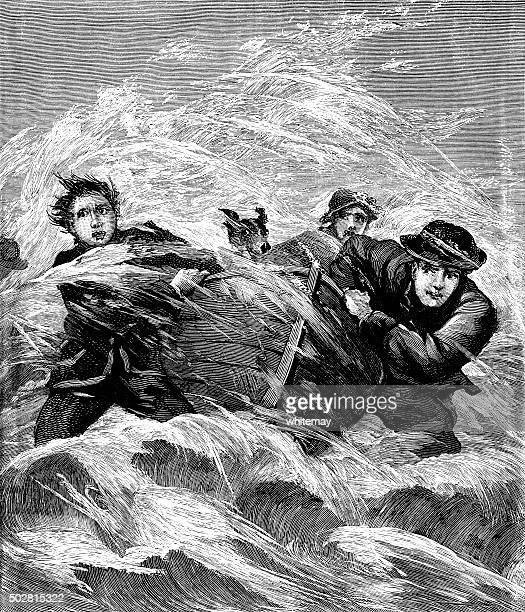 Men bringing a boat ashore in rough seas