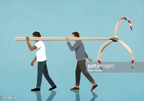 men carrying weathered wind turbine - destruction stock illustrations
