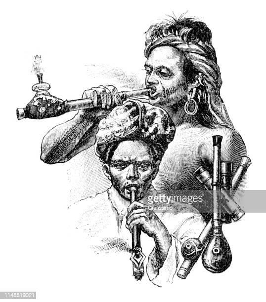 men in java and sumatra smoking pipe with opium 1894 - quitting smoking stock illustrations, clip art, cartoons, & icons