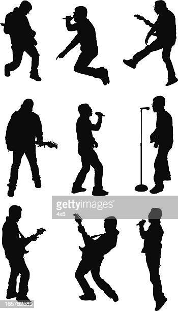 Men jamming and rocking out in a musical performance