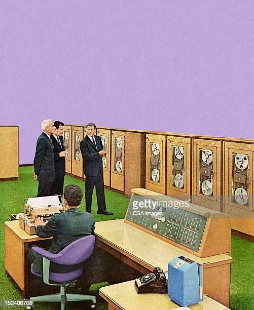 Men Looking at Office Equipment