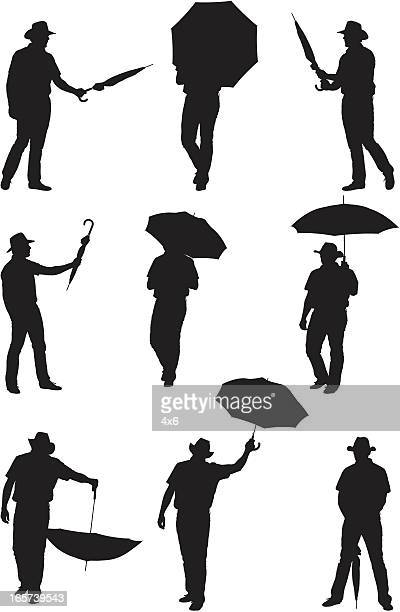men posing with umbrellas - legs apart stock illustrations