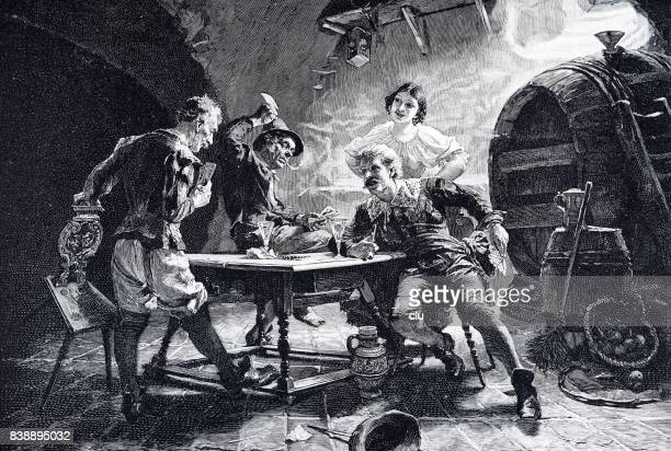 Men sitting in wince cellar playing cards